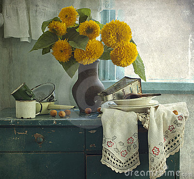 Sunflowers and kitchen utensil
