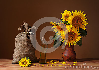 Sunflowers in a vase and a sack of jute