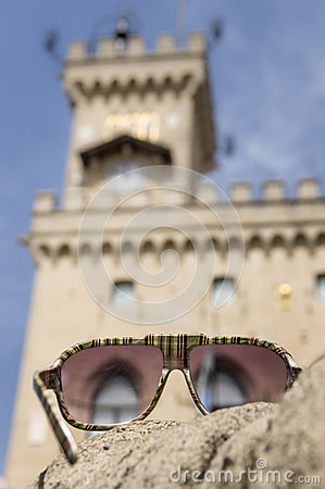 Sunglasses against San Marino Government Palace