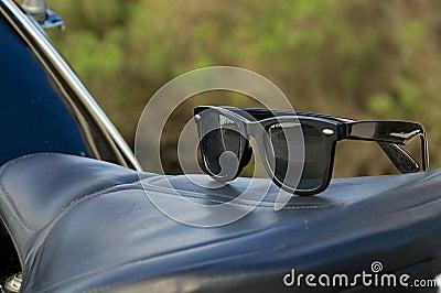 Sunglasses on motorcycle saddle