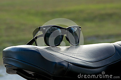 Sunglasses on motorcycle seat