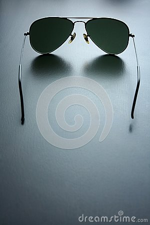 Free Sunglasses On A Wooden Table Stock Photo - 57396030