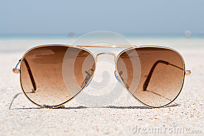 Sunglasses on a sand beach