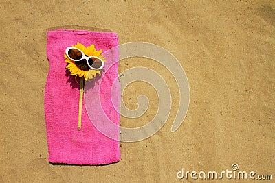 Sunglasses on sandy beach