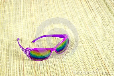 Sunglasses on straw mat