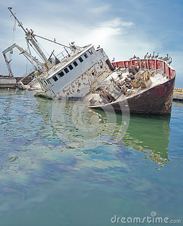 Sunken boat at the dock