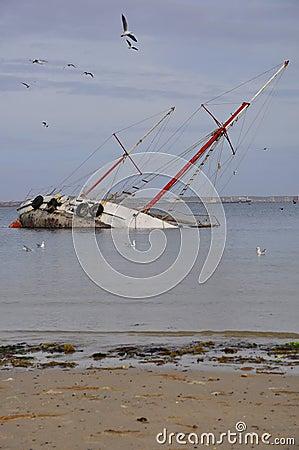 Sunken yacht in sea
