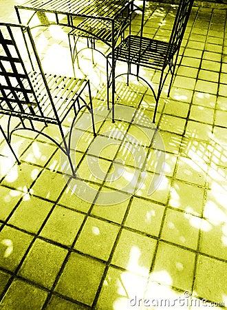 Sunlight on streetside cafe