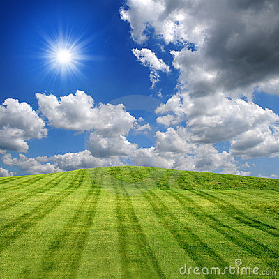 Sunny Green Field and Clouds