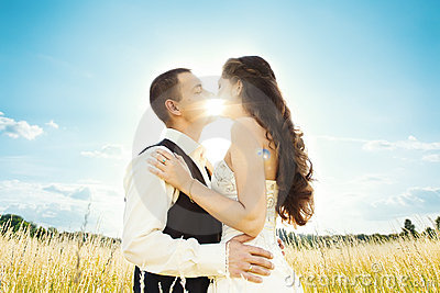 Sunny kiss. bride and groom