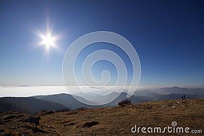 Sunny sky above clouds