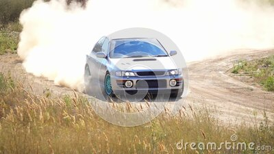 Sports Car With a Cloud of Dust on the Bend of the Rally Track. Slow Motion stock footage