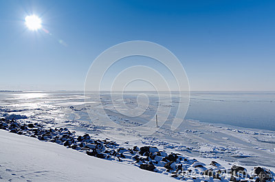 Sunny view across frozen lake