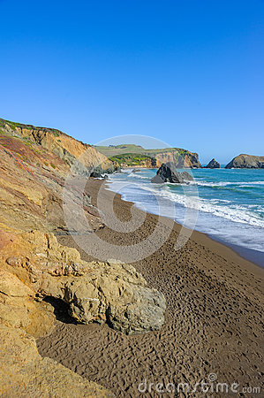 Sunny view on empty wild Rodeo Beach in California