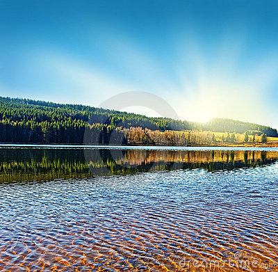 Sunrise above lake