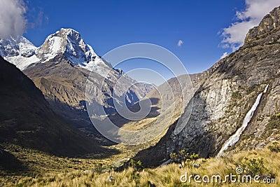 Sunrise above mountain Huascaran in Peru with waterfall Stock Photo