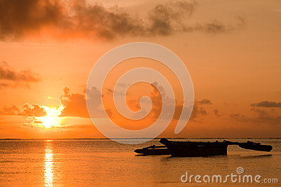 Sunrise with an African boat