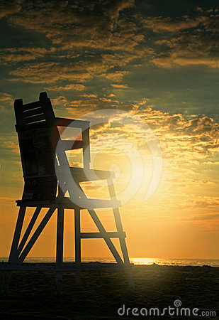 Sunrise on beach with lifeguard seat
