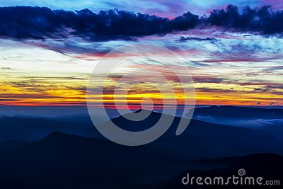 Sunrise dawning at Phu Ruea Stock Photo