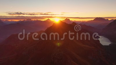 Sunrise in the Dolomites. Aerial view of mountains and valleys. Lago di Fedaia, South Tyrol and Trentino. Autumn in. Sunrise in the Dolomites. Aerial view of stock footage