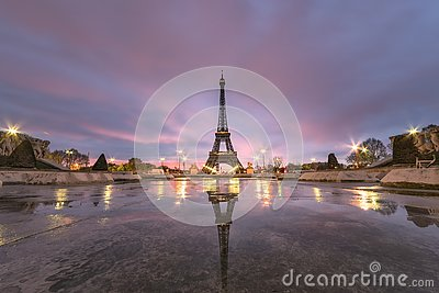 Sunrise on the Eiffel tower reflection