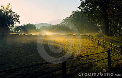 Sunrise in foggy landscape