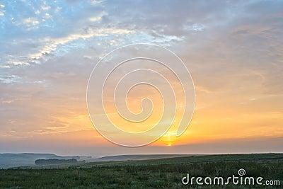 Sunrise and grassland