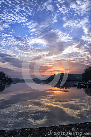 Sunrise on Lake with Clouds