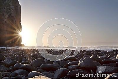 Sunrise landscape with rocks cliffs