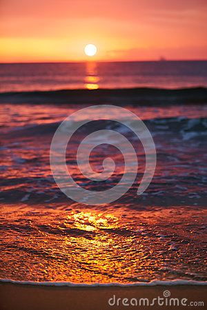 Sunrise light shining on ocean wave