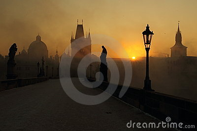 Sunrise on the misty Charles bridge