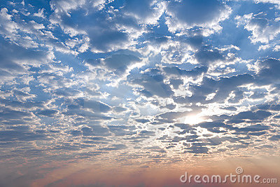 Sunrise, morning sky and big fluffy clouds.