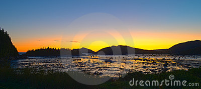 Sunrise in mountains at low tide