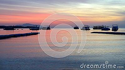Sunrise at Naama Bay, Red Sea and motor yachts
