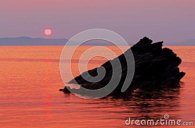 Sunrise over calm Aegean sea