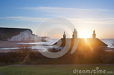 Sunrise over coastguard cottages at Seaford Head with Seven Sist