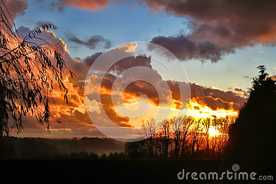 Sunrise over Countryside in fog in Normandy France