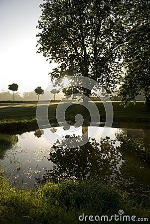 Sunrise over countryside lake
