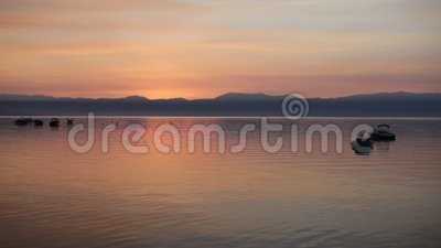 Sunrise over crystal clear lake stock video footage