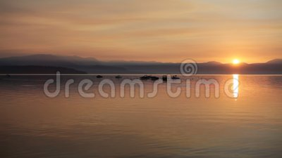 Sunrise over crystal clear lake stock footage