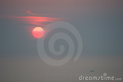 Sunrise over fishing boat