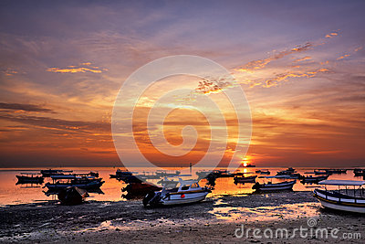 Sunrise over fishing boats on Bali