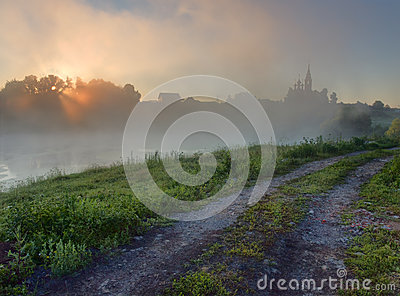 Sunrise over foggy lake