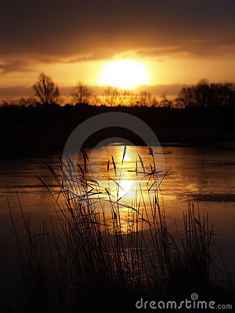 Sunrise over frozen lake