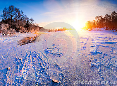 Sunrise over the frozen river