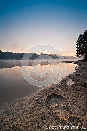 Sunrise over the misty lake