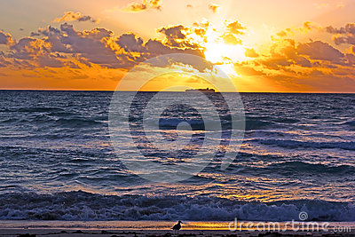 Sunrise over the ocean with clouds.