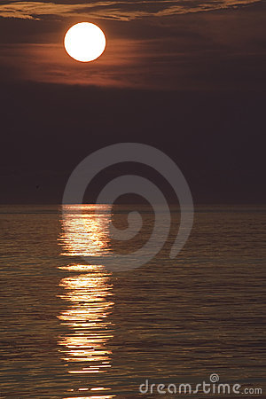 Sunrise over ocean waves vertical