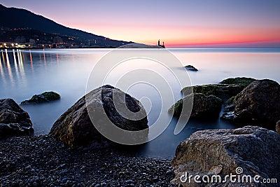 Sunrise over rocky black sea coastline
