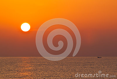 Sunrise over the sea and fishing boat